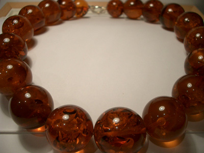 Massive amber necklaces (cognac round beads with spangles)