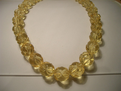 Lemon colour amber necklace (round carved beads)