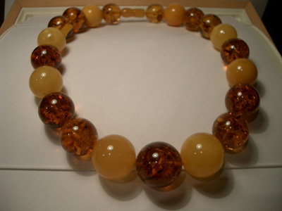 Massive multicolor amber necklace - round baltic beads