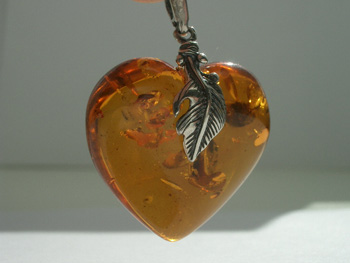 Honey amber heart pendant with spangles