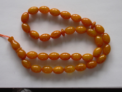 Orange amber rosary 33 olive amber beads - prayer beads, worry beads